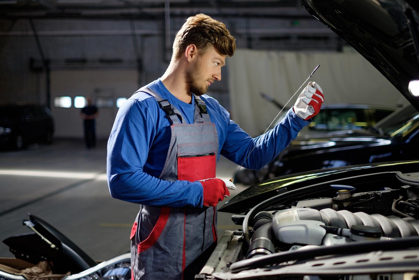 Mechanic-checking-oil-level-in-104495669.jpg